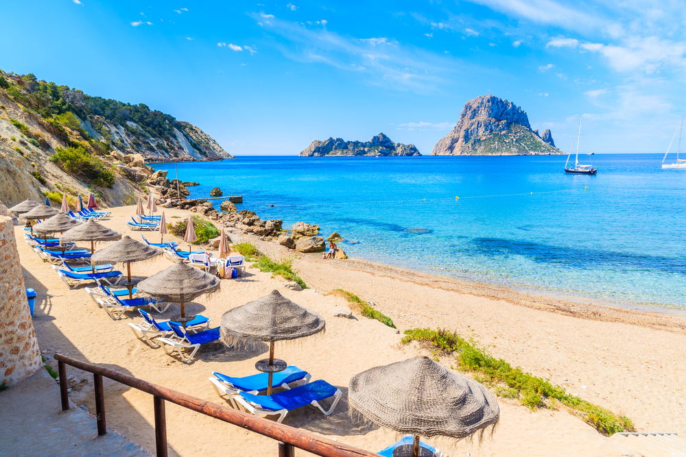 best place for beach clubs cala d'hort beach ibiza island spain