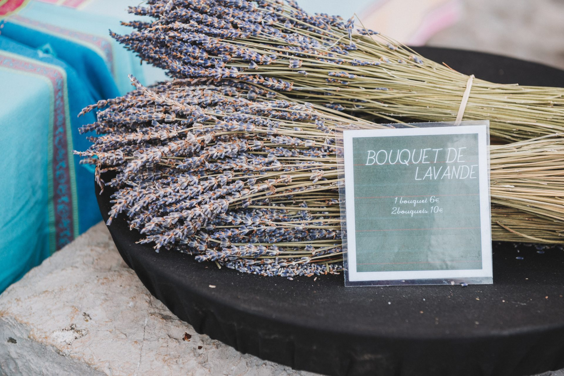 Bouquet of lavender placed on a market stand on a typical provencal market in St Tropez